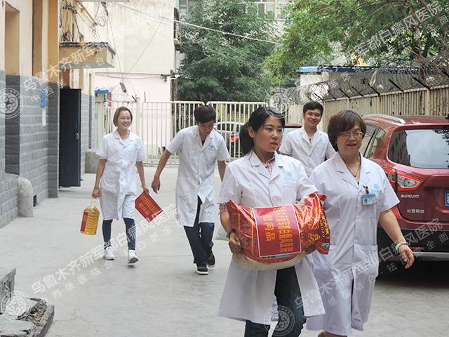 新军都医院看望贫困患者艾日普